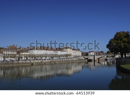 Reflection of buildings on Saone river in Chalon-sur-Saone France - stock photo