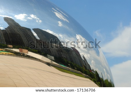 "Reflection of Chicago skyline in ""Cloud Gate"" sculpture in Millenium Park."
