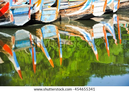 Reflection of colorful boat at Taungthaman Lake, Amarapura, Myanmar - stock photo