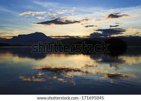 Reflection of colorful sunrise and Mount Kinabalu at Sabah, Borneo, Malaysia - stock photo