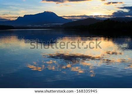 Reflection of colorful sunrise at Sabah, Borneo, Malaysia - stock photo