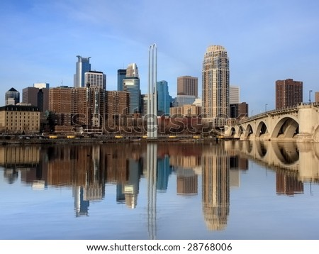 Reflection of downtown Minneapolis in Mississippi river without wires - stock photo