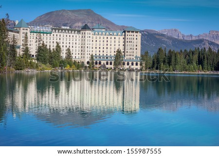 Reflection of Fairmont Chateau Hotel in Lake Louise - stock photo