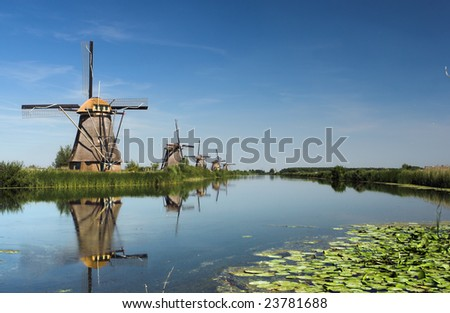 Reflection of five dutch windmills - stock photo