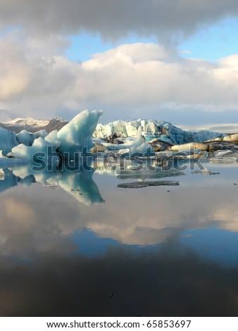 Reflection of floating icebergs inside Jokulsarlon glacier lake in Iceland. - stock photo