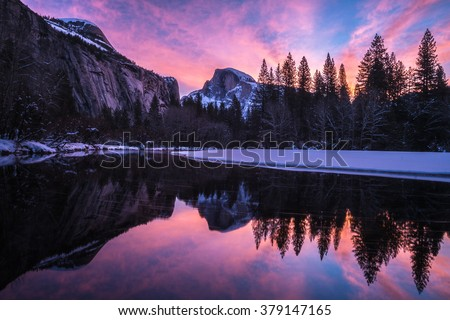 Reflection of half dome at Yosemite National park This is the best sunrise spot for the half dome. (the picture may be blur due to the light but I would like to focus on the color of the pink sky) - stock photo