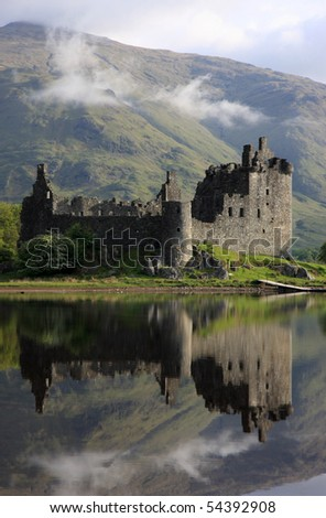Reflection of Kilchurn Castle in Loch Awe, Scotland. - stock photo