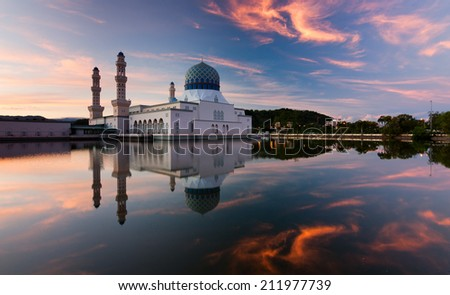 Reflection of Kota Kinabalu mosque at sunrise in Sabah, East Malaysia, Borneo - stock photo