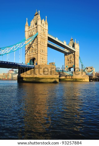 Reflection of London Tower Bridge on the water - stock photo