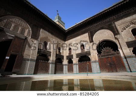 reflection of Madrassa in Marrakech, Morocco - stock photo