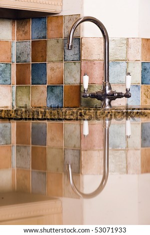 Reflection Of Modern Tap In Kitchen - stock photo