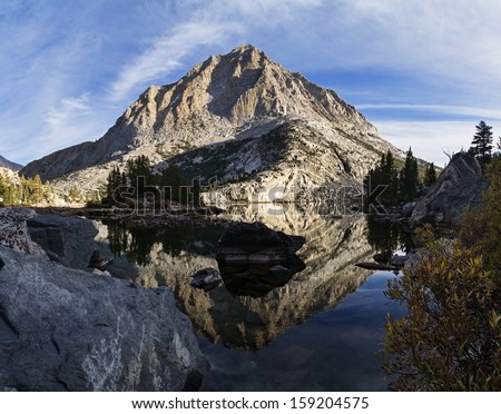 reflection of mountain in Pine Lake in the Sierra Nevada mountains - stock photo