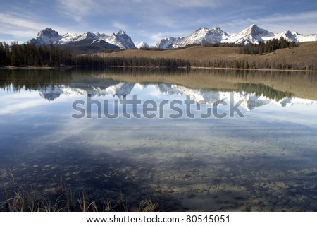 Reflection of Mountain Range Smooth Waters Redfish Lake Idaho Sawtooth Mountain Wilderness - stock photo