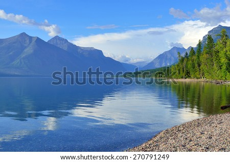 Reflection of Mountains in McDonald lake in Glacier National Park, Montana in summer - stock photo