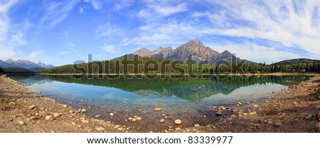 Reflection of mountains in smooth water of Pyramid lake (Jasper National Park, Alberta, Canada)