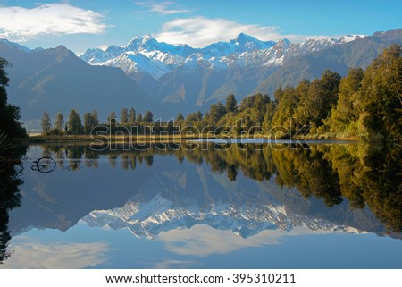 Reflection of mountains in the lake Matheson, New Zealand landscape