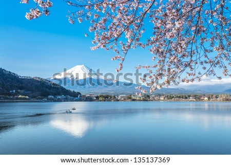 Reflection of Mt Fuji and Cherry Blossom on lake Kawaguchiko - stock photo
