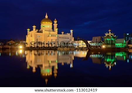 Reflection of Omar Ali Saifuddien mosque at night in  Bandar Seri Begawan - stock photo