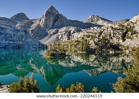 reflection of Painted Lady Mountain in Rae Lake in Kings Canyon National Park - stock photo