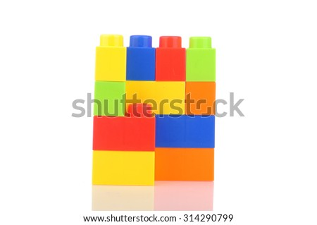 Reflection of Plastic Colorful Block On White Background
