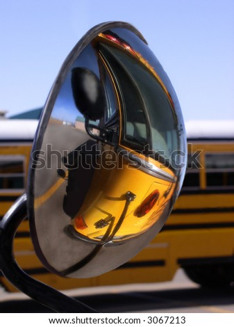 reflection of school bus in side view mirror - stock photo