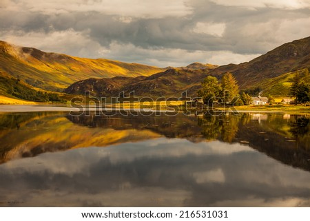 Reflection of Scottish Higlands - stock photo