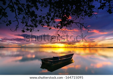 Reflection of Single Boat During Sunrise under the Tree
