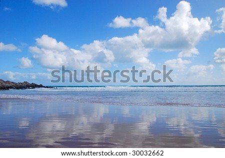 "Reflection of sky on a beach near Victor Harbor, ""south Australia"", Australia - stock photo"