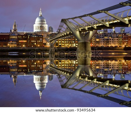 Reflection of St Paul's Cathedral and the Millenium footbridge from the River Thames, London - stock photo
