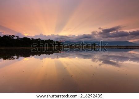 Reflection of sunrays at Kota Belud, Sabah, East Malaysia, Borneo - stock photo