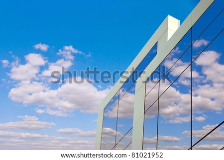 Reflection of the beautiful sky in a new building - stock photo