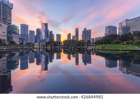 Reflection of the buildings surrounding KLCC lake