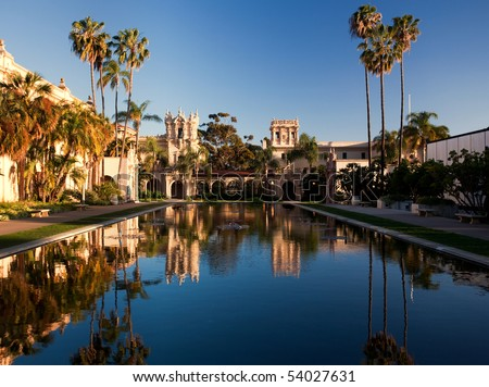 Reflection of the Casa de Balboa and House of Hospitality in Balboa Park in San Diego reflected in Lily Pond - stock photo