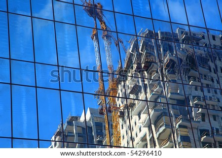Reflection of the construction work site - stock photo