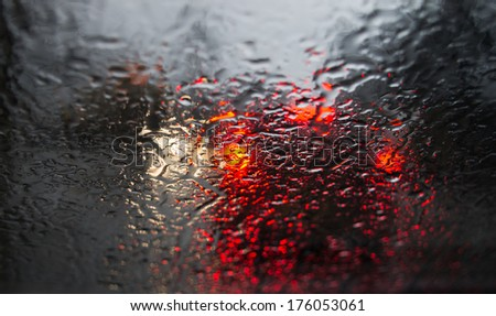 Reflection of the electric light in the rain. - stock photo