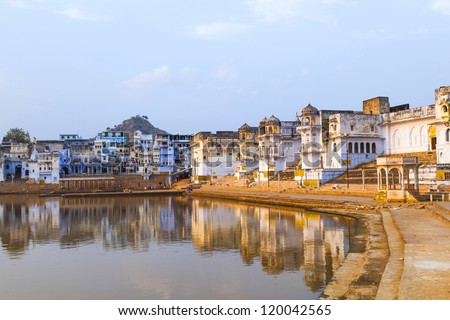 reflection of the ghats in Pushkar - stock photo