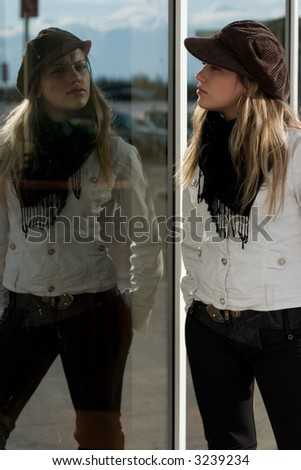 Reflection of the girl in a show-window