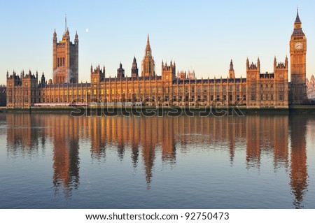 Reflection of the House of Parliament in water, river thames, London, UK - stock photo