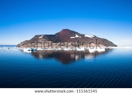 Reflection of the island in Antarctica - stock photo