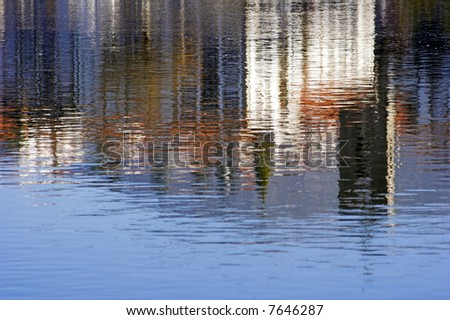 Reflection of the medieval city of Ponte de Lima on the Lima river (north of Portugal) - stock photo