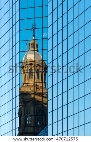 Reflection of the Metropolitan Cathedral in a glass wall in Plaza de Armas, Santiago