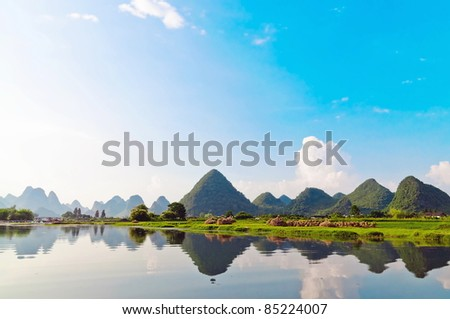 Reflection of the mountains in Li River landscape in morning light, Yangshuo near Guilin, - stock photo