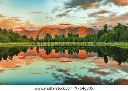 Reflection of the mountains in Matheson lake - stock photo