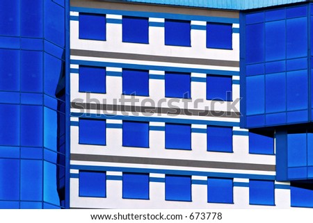 Reflection of the sky on a modern office building - stock photo