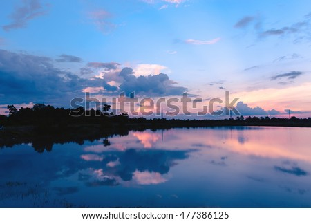 Reflection of the sunset on the lake