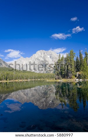 Reflection of the Tetons in Grand Teton National Park - stock photo