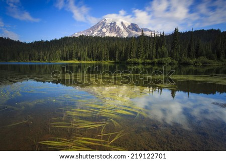 Reflection of water and mountains at Mount Rainier National Park - stock photo