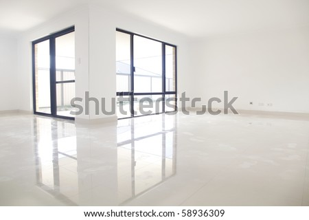 Reflection of white doors onto porcelain tiles. - stock photo