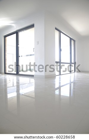 Reflection of white doors onto porcelain tiles, vertical composition. - stock photo