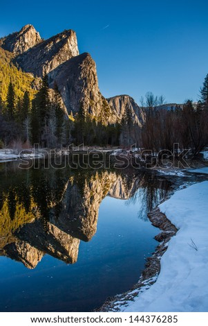 Reflection of Yosemite Three Sisters in Winter, Yosemite National Park, CA - stock photo